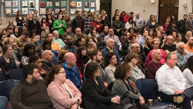 Community members attend at a town hall meeting Thursday about recent bomb threats at the Siegel Jewish Community Center in Talleyville.