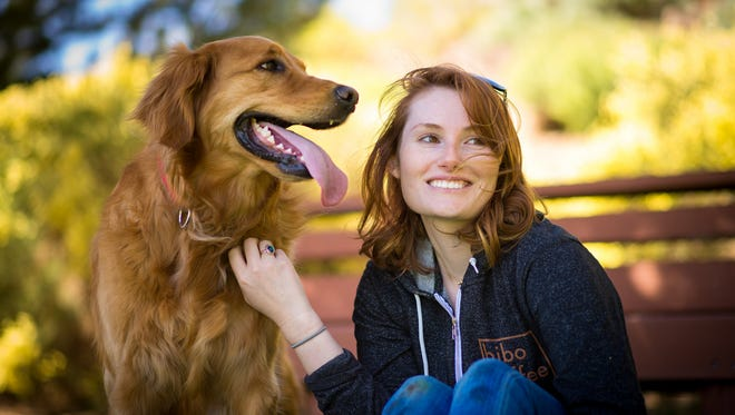 Weston Spann hangs out with her golden retriever Ruby in  Reno's old southwest neighborhood.