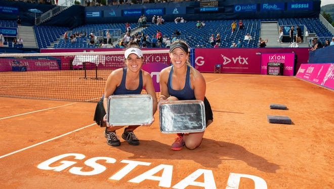 Desirae Krawczyk (left) celebrates her first WTA title with doubles partner Alex Guarachi in Gstaad, Switzerland on Sunday.