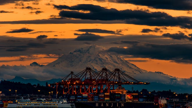Mt. Rainier amidst a warm, colorful, evening sky on Oct. 18 in Seattle, Wash.