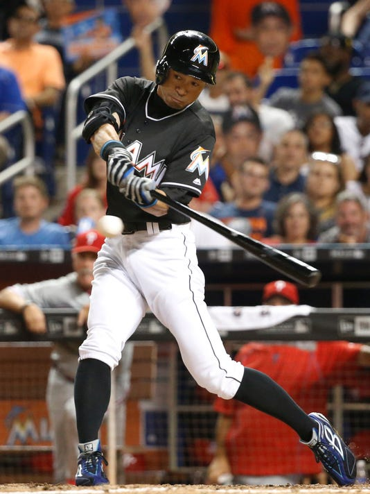 Miami Marlins' Ichiro Suzuki hits a single during the eighth inning of a baseball game against the Miami Marlins, Tuesday, July 26, 2016, in Miami. Suzuki made his first start in five games and went 1 for 5, giving him 2,997 career hits. He also stole a base and scored a run as the Marlins defeated the Phillies 5-0. (AP Photo/Wilfredo Lee)