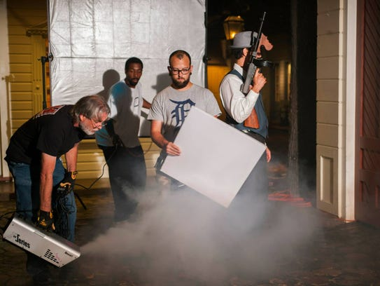 The 'Gangster Report' crew creates a foggy scene during