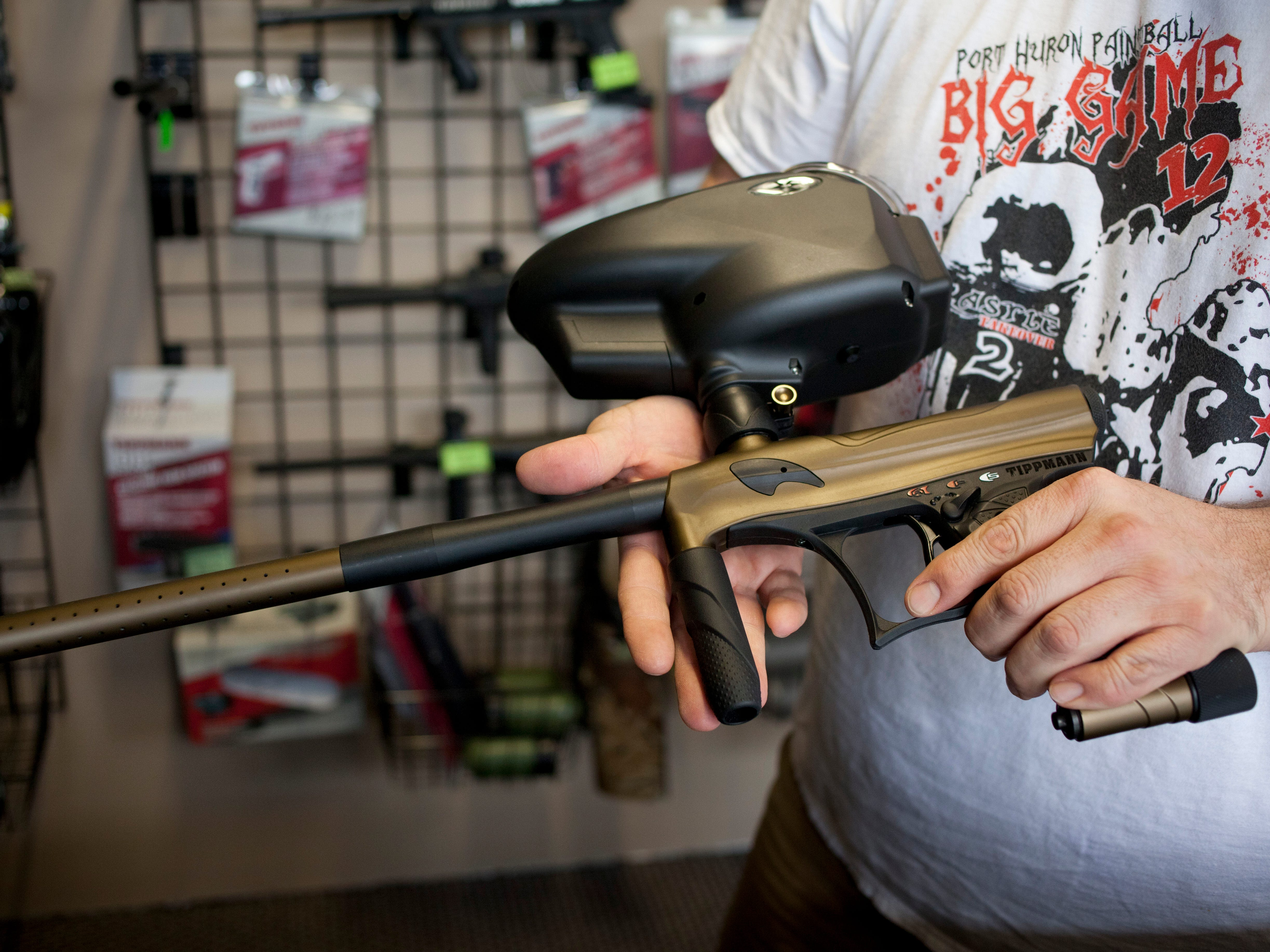Jason LaTurno shows a paintball marker Thursday, April 9, 2015 at International Paintball in Port Huron.