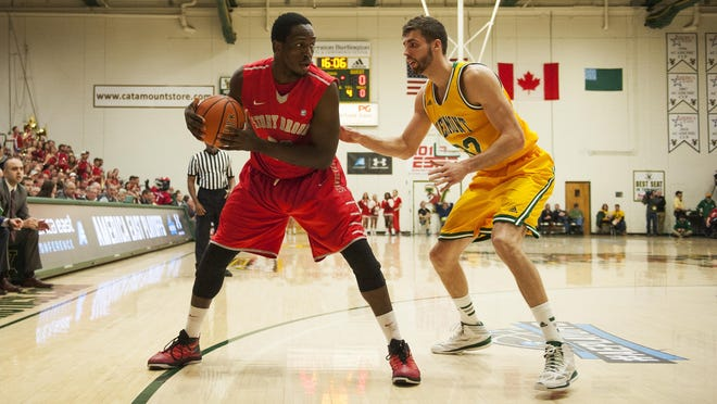 Catamounts forward Ethan O'Day (32) guards Stony Brook's Jameel Warney (20) in last year's America East semifinals at Patrick Gym.