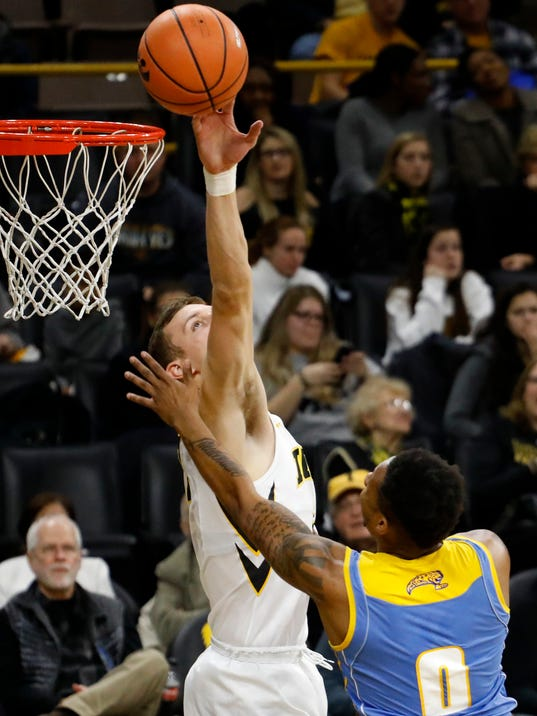 Iowa forward Jack Nunge, left, blocks a shot by Southern University guard Richard Lee (0) during the first half of an NCAA college basketball game, Sunday, Dec. 10, 2017, in Iowa City, Iowa. (AP Photo/Charlie Neibergall)
