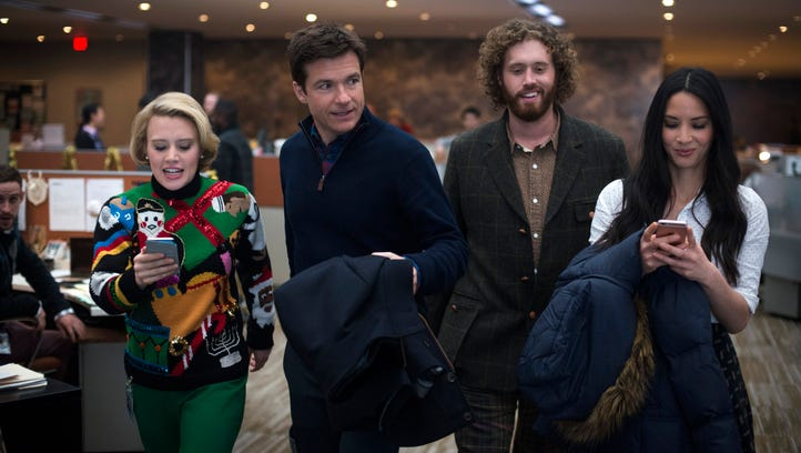 Courtney B. Vance and T.J. Miller revel in the festivities of 'Office Christmas Party.'