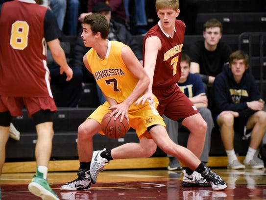 St. Cloud Cathedral's Mitchell Plombon, Gold, keeps