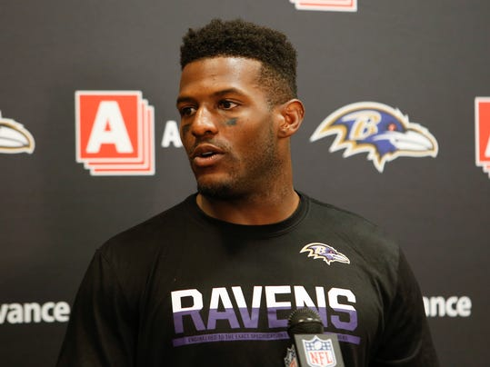 FILE - In this Sept. 18, 2016, file photo, Baltimore Ravens wide receiver Mike Wallace speaks to the media during a news conference after an NFL football game against the Cleveland Browns, in Cleveland. Wallace plays against his former team, the Miami Dolphins, on Sunday. (AP Photo/Ron Schwane, File)