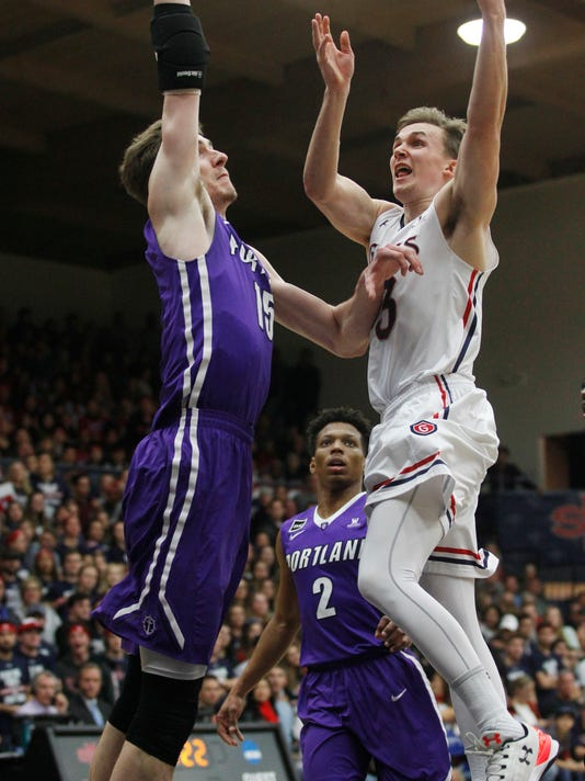 Saint Mary's Emmet Naar, right, shoots as Portland's Philipp Hartwich defends during the first half of an NCAA college basketball game Saturday, Jan. 27, 2018, in Moraga, Calif. (AP Photo/George Nikitin)