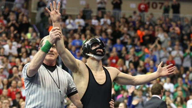 Union senior Max Thomsen celebrates his fourth Iowa state wrestling championship after beating Bondurant-Farrar senior Caleb Coleman for a title at 145 pounds in Class 2A on Saturday, Feb. 21, 2015, during the 2015 Iowa state wrestling championships at Wells Fargo Arena in Des Moines, Iowa.