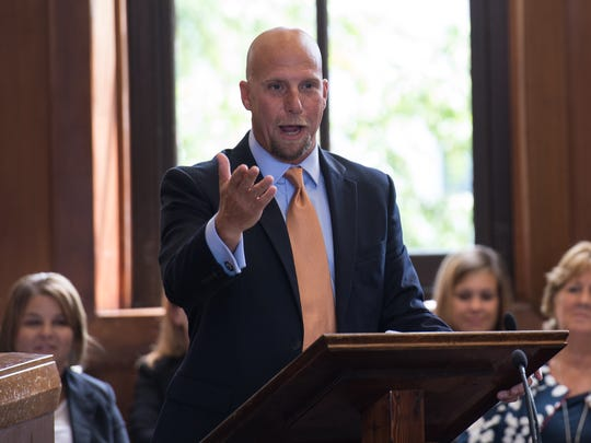 Richard Brueckner, Assistant State's Attorney, speaks during the investiture of Matthew Maciarello on Friday, July 22, 2016.