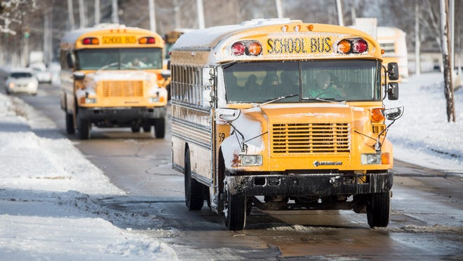 Students at Southside Middle School load up the buses and begin to head home Monday after the weekend weather caused a list of school delays in the morning. School districts across the area including Muncie look at road conditions and extreme temperatures when choosing delays.