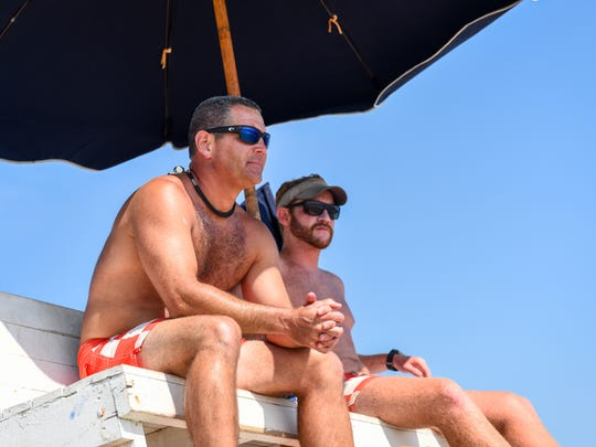 Bethany Beach lifeguard captain Joe Donnelly surveys the beach with fellow lifeguard Patrick Berns on Wednesday, July 11.
