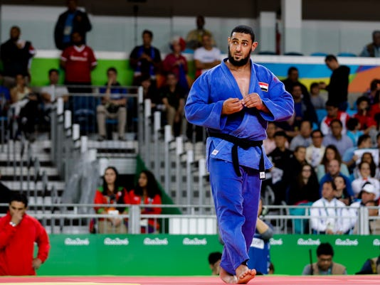 Egypt's Islam El Shehaby reacts after he losing to Israel's Or Sasson, during the men's over 100-kg judo competition at the 2016 Summer Olympics in Rio de Janeiro, Brazil, Friday, Aug. 12, 2016. (AP Photo/Markus Schreiber)