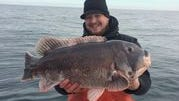 Shane Burke, 26 of Holmdel, holds his 23-pound blackfish he caught out of Wildwood on Jan. 30.