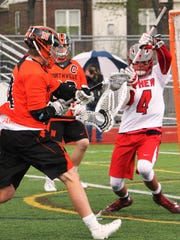 Northville's Zach Tardich (left) scored three goals