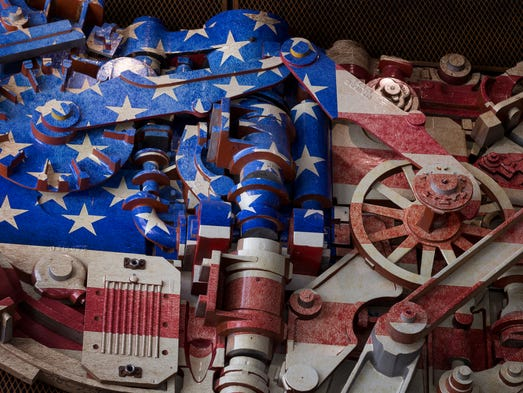 Metal gears as a U.S. flag in the front entryway at