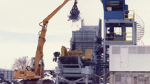 A $1.6 million metal shredder, is shown in operation on property at Midway Iron and Metal Inc. in 1996. Later, plans went into effect to construct a building around the machine to help reduce the noise level.