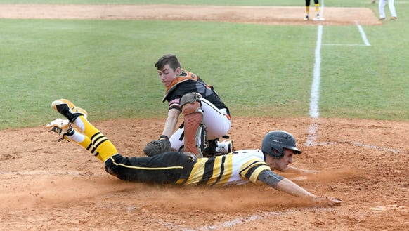 Murphy's Kendal Keating slides safely into home plate behind Rosman catcher Brennan Chapman during their game at Rosman High School on Friday, March 16, 2018. The Bulldogs defeated the Tigers 18-3 in five innings.