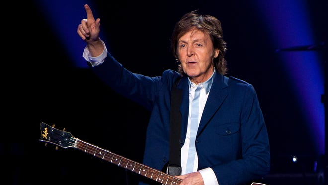 Paul McCartney performs in concert as part of his Out There tour at Philips Arena in Atlanta.