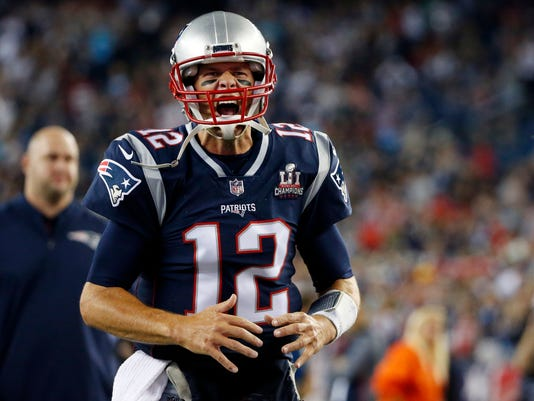 New England Patriots quarterback Tom Brady shouts as he takes the field before an NFL football game against the Kansas City Chiefs, Thursday, Sept. 7, 2017, in Foxborough, Mass. (AP Photo/Michael Dwyer)