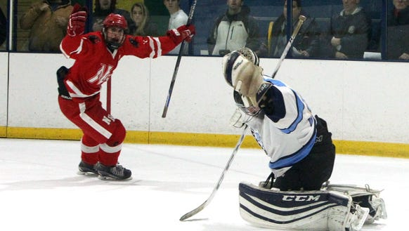 North Rockland's Bryan Jensen scores past Suffern goalie