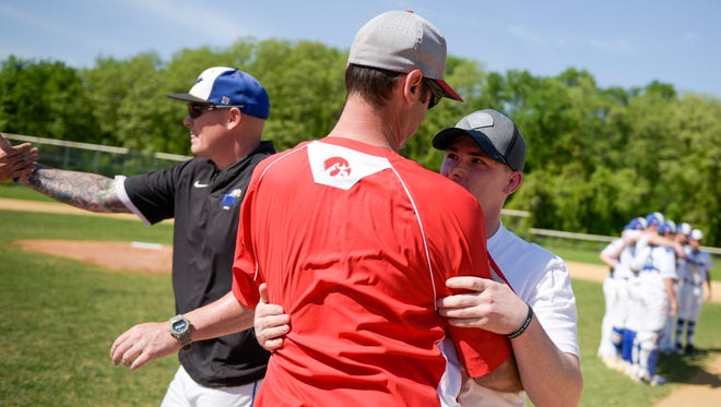 Haddon Township head coach Doug Richardson, left, embraces Matt Myers, 26, before the second annual Myers Cup Game Friday, May 11, 2018 at Paul VI High School in Haddonfield, N.J. Matt's dad Rich Myers, a Haddon Township youth coach, passed away from Amyotrophic Lateral Sclerosis (ALS).