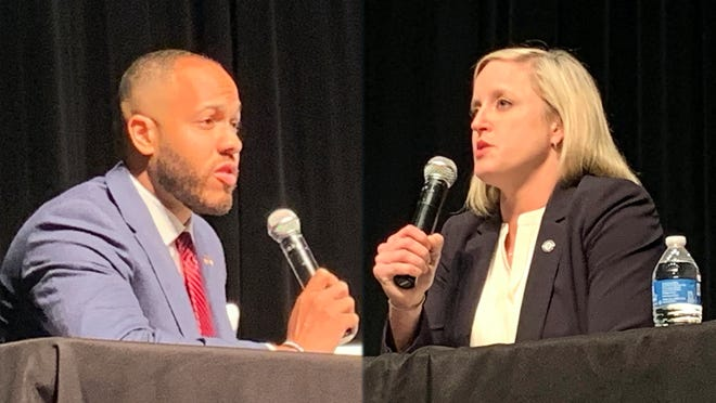 Augusta Judicial Circuit District Attorney candidate Jared Williams, left and incumbent Natalie Paine, right, discuss their platforms and why voters should pick them in this year's election during a Columbia County Chamber of Commerce forum at Columbia County Library in Evans Wednesday. Oct. 21.
