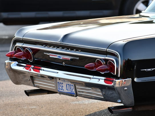 Wicked tail lights extend from this Chevrolet during