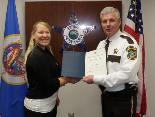 Alicia Meyer of Sauk Rapids and Sheriff Brad Bennett.JPG