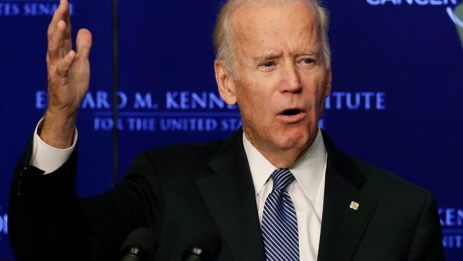 """Vice President Joe Biden speaks at the Edward M. Kennedy Institute for the United States Senate, Wednesday, Oct. 19, 2016 in Boston, about the White House's cancer """"moonshot"""" initiative — a push to throw everything at finding a cure within five years. (AP Photo/Elise Amendola)"""