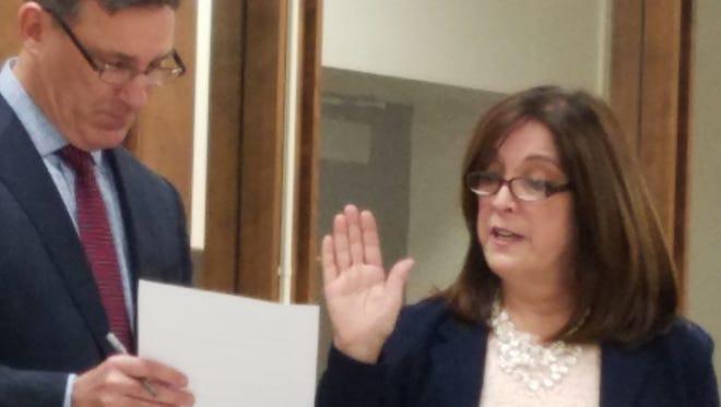 Ellen Brain is sworn in as mayor of Somerville by Borough Administrator Kevin Sluka.