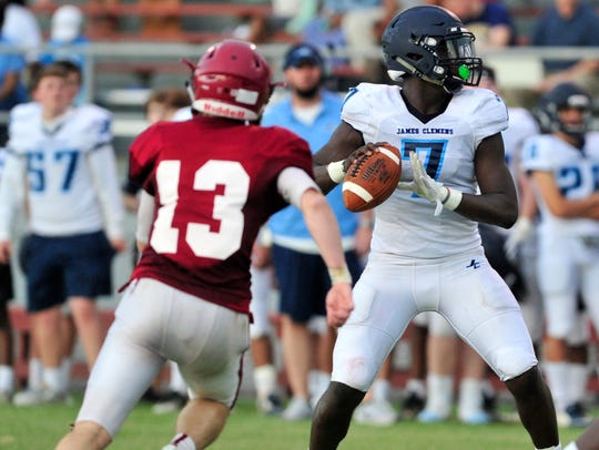 James Clemens Jet Jamil Muhammad (7) in action against