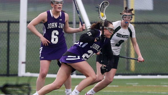 John Jay's Charlotte Wilmoth (25) drives to the goal