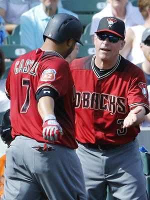 Arizona Diamondbacks' Welington Castillo (7) is greeted by manager Chip Hale (3) after his solo home run in the 4th inning during their spring training game against the Colorado Rockies Wednesday, March 2,, 2016 at Salt River Fields at Talking Stick.