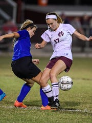Henderson's Hannah Jones battles with Crittenden's Emily Tinsley as the 11th-ranked Henderson County Lady Colonels play Crittenden County in the first round of the Second Region Girls Soccer Tournament Monday at Colonel Field, October 17, 2016.