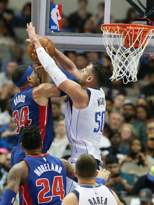 Detroit Pistons forward Tobias Harris (34) is defended by Dallas Mavericks center Salah Mejri (50) during the second half of an NBA basketball game in Dallas, Wednesday, Dec. 20, 2017. The Mavericks 110-93. (AP Photo/LM Otero)