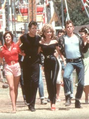 """Stockard Channing, left, John Travolta, Olivia Newton-John and Jeff Conaway co-starred in the surprise hit musical, """"Grease."""""""