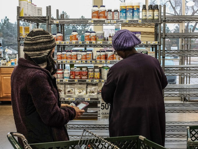 Two women shop what is left of the supplement section