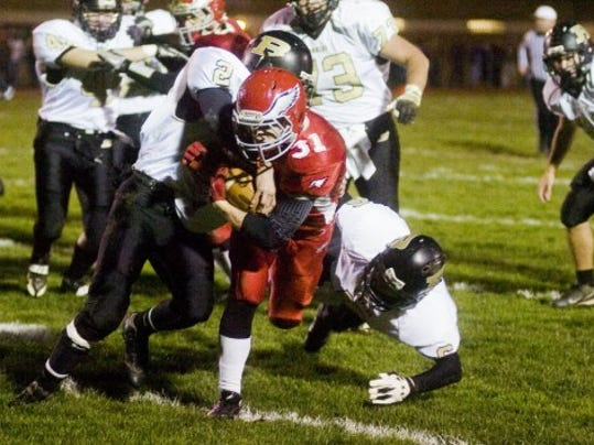 Bermudian Springs' Zach Stroup dodges past Biglerville defensemen during Friday night's game at Bermudian. (THE EVENING SUN SHANE DUNLAP)