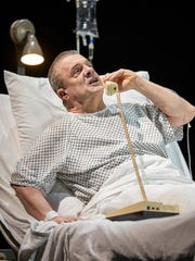 "Nathan Lane in a scene from ""Angels in America: Perestroika."""