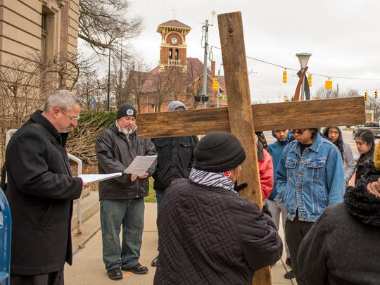 The Way of the Cross stopped at different sites in downtown Battle Creek to reflect on Good Friday.