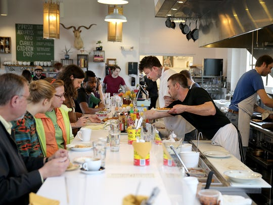 Milktooth chef/owner Jonathan Brooks centerstage in the open kitchen at the lively Milktooth restaurant. The 534 Virginia Ave. spot, in Fletcher Place, serves creative twists on breakfast and lunch comfort food.
