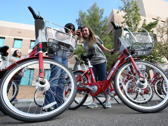 Cynthia Cano, left, and Megan Ortega, both of the El Paso office of U.S. Rep. Beto O'Rourke, take a selfie before the start of the SunCycle bike share program kickoff ride Wednesday in Downtown El Paso.