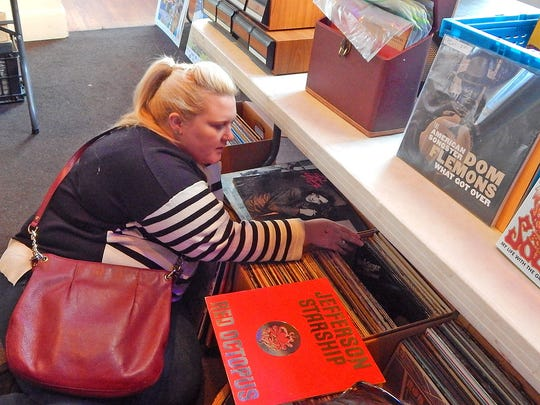 Renna Moore of Jackson hopes to find some of her favorite '70s and '80s rock music while spending time at the Central Mississippi Record Convention at Duling Hall in Jackson on Saturday.