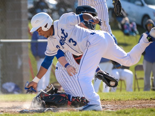 Cedar Crest's Iziah Trimble tumbles after getting tagged out by Northern Lebanon catcher Chase Dubendorf during the Vikings' 7-4 road win Tuesday.