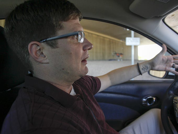 Jeremy Reed from Mesa drives through Phoenix to the