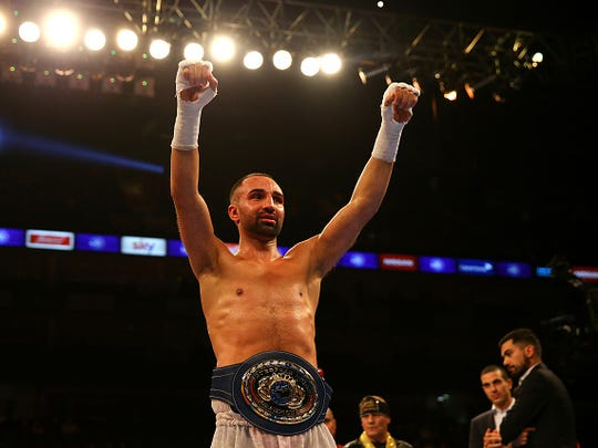 Paulie Malignagg celebrates beating Antonio Moscatiello for the vacant EU Welterweight Championship during the Matchroom Boxing promotion 'Bad Intentions' at The O2 Arena on December 12, 2015 in London, England.