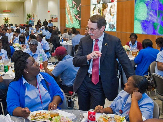 President and CEO Dr. James Downing greets employees