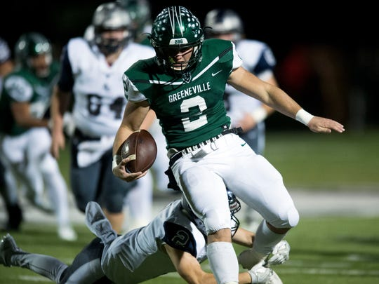 Greeneville quarterback Cade Ballard runs for yards against Anderson County on Nov. 17, 2017.